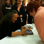 Beloved wife chatting with Kitaro while getting her CDs signed.