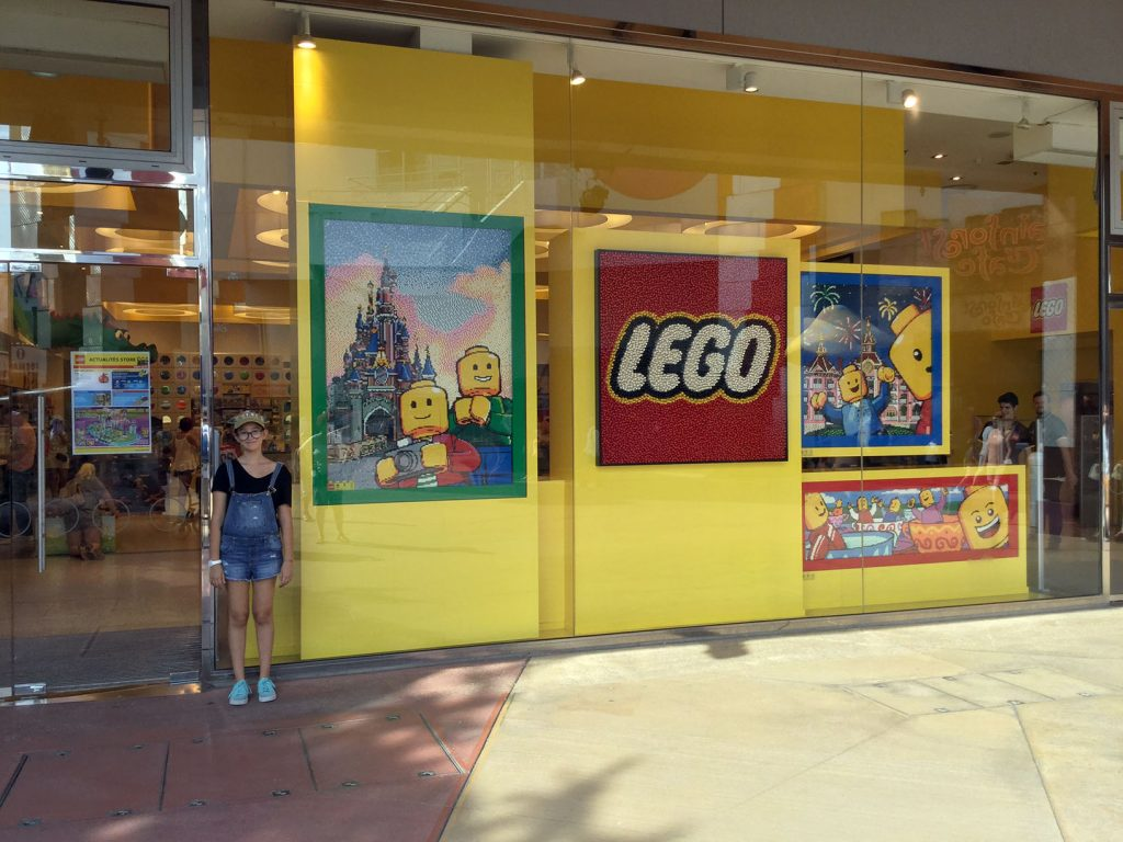 My daughter, Dila, so cheerful in front of the LEGO store 'Disneyland', Paris